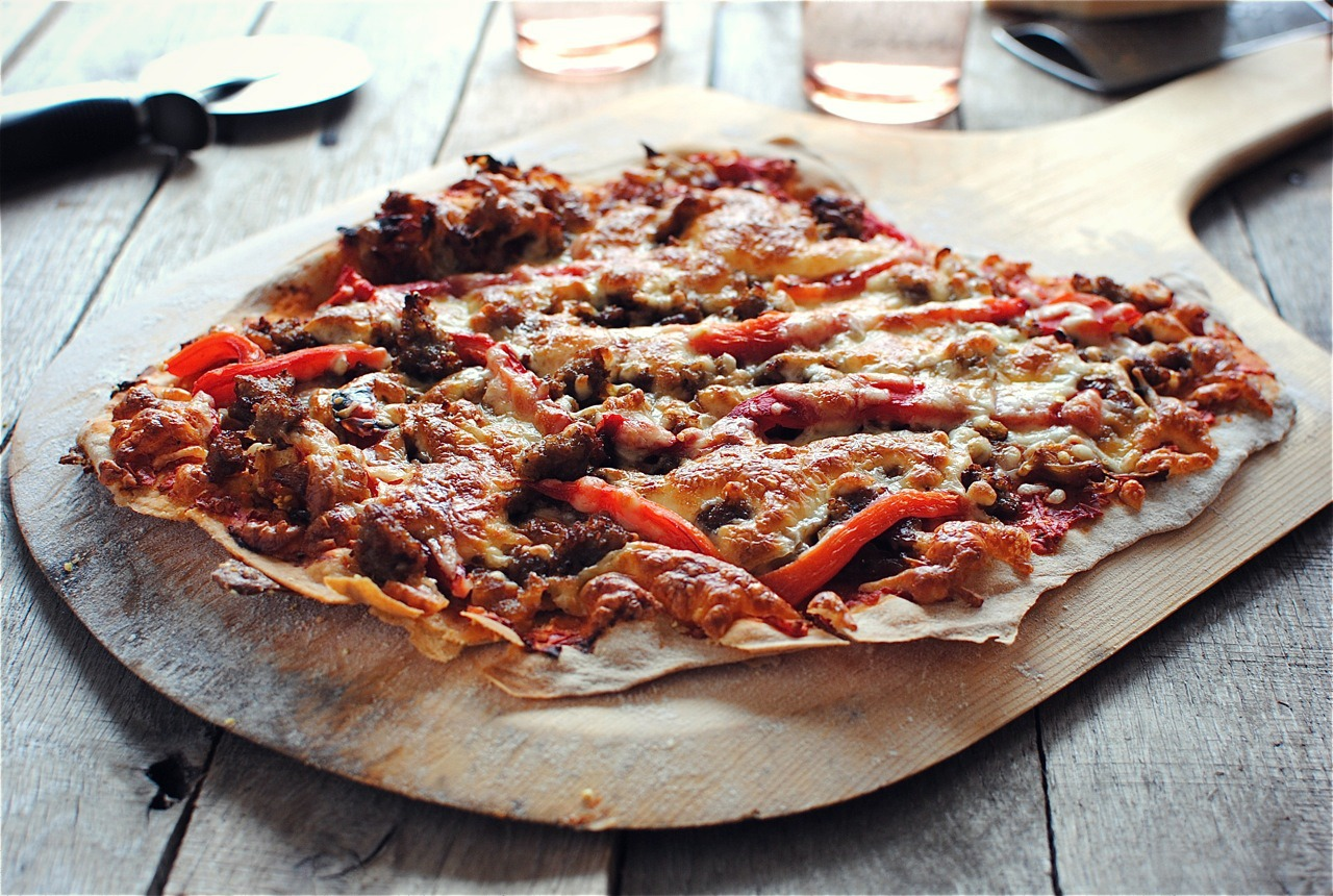 Thin Crust Pizza with Caramelized Onions, Sausage and Roasted Red ...