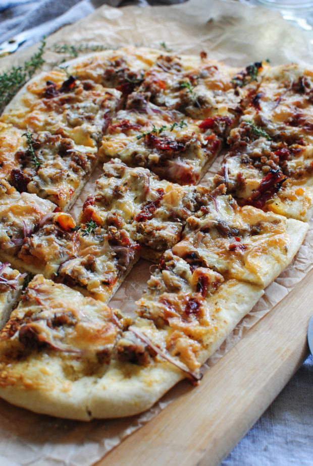 Sun Dried Tomato Pizza with Sausage and Roasted Garlic / Bev Cooks
