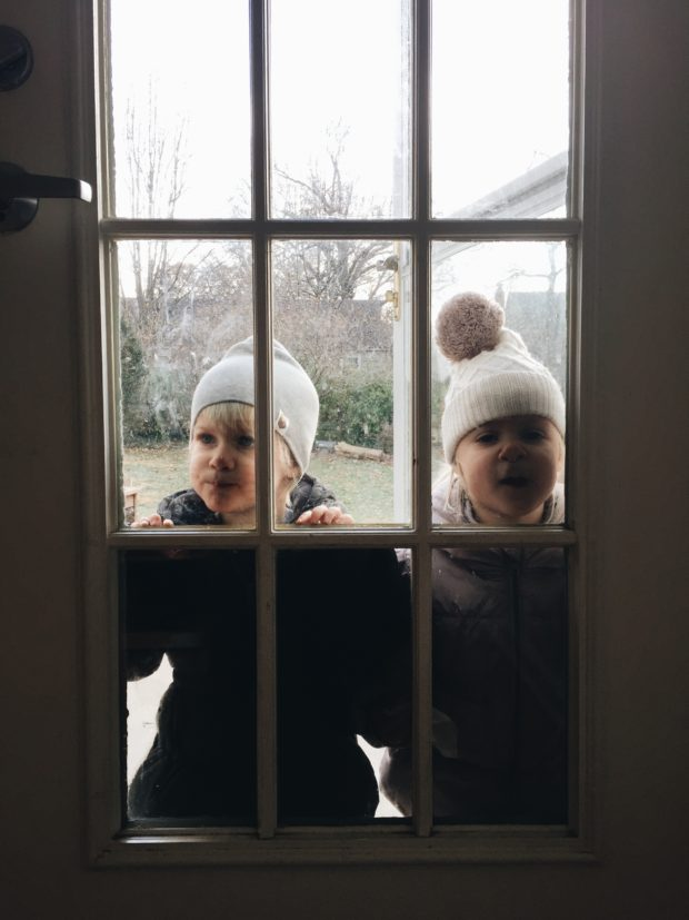 Toddlers in Winter Window