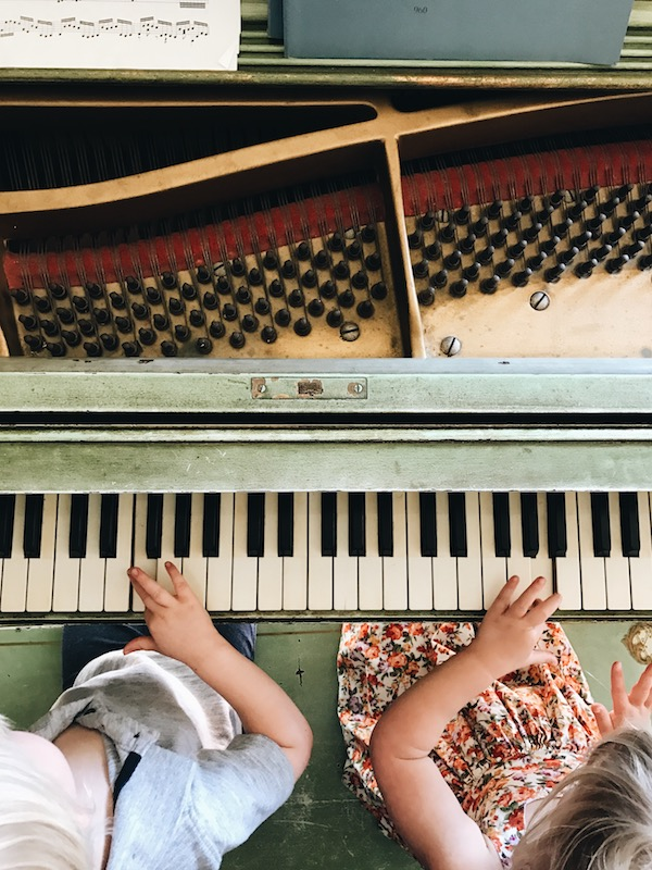 kids playing vintage piano