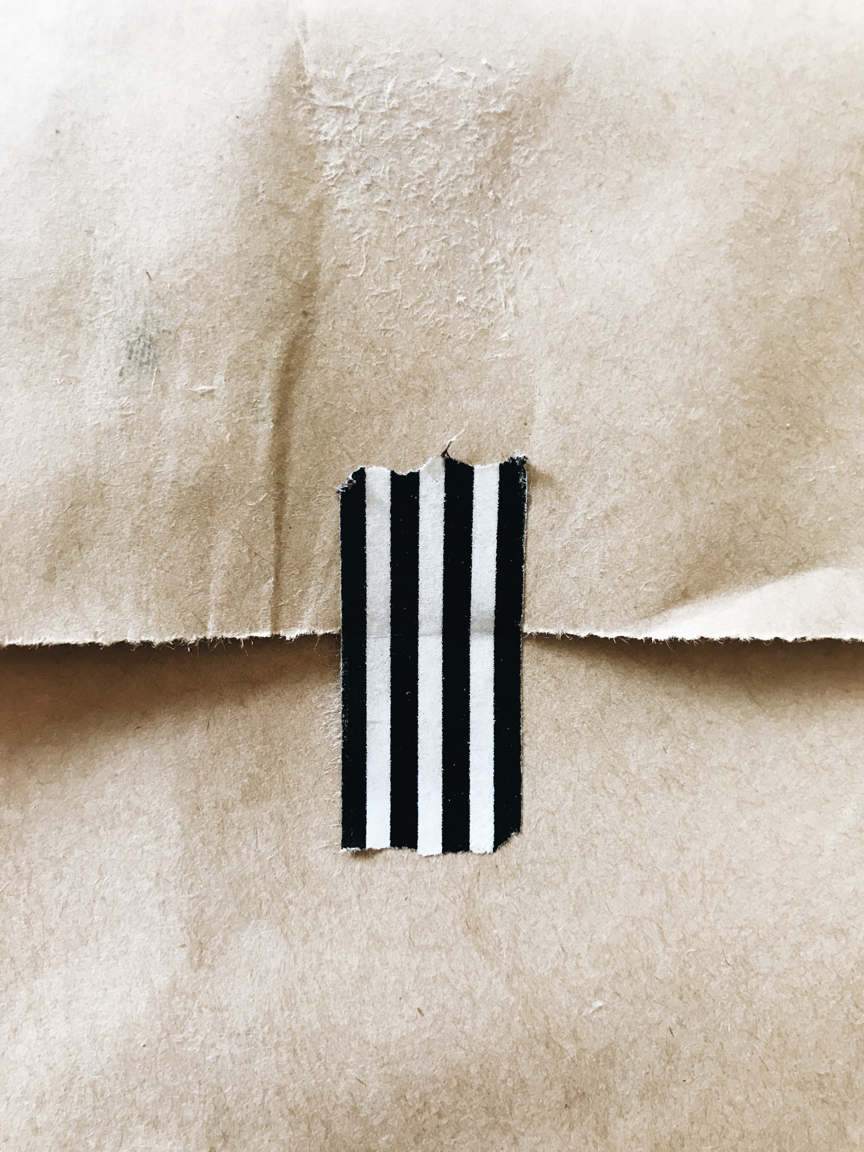 black and white tape on brown bag