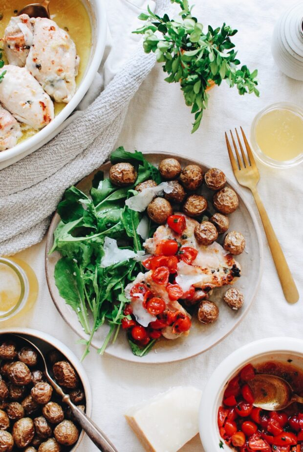 Baked Chicken Thighs with Roasted Potatoes, Garden Greens and a Raw Tomato Drizzle / Bev Cooks